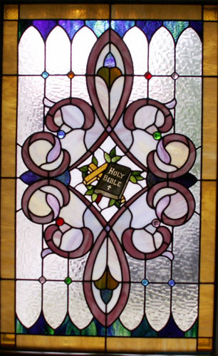 bible & cross stained glass window