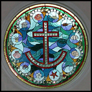round stained glass anchor and cross sealife